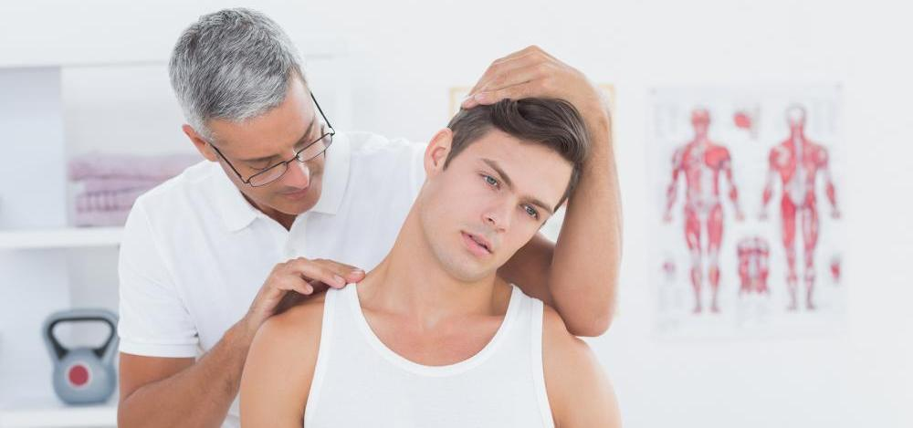 bigstock-Doctor-doing-neck-adjustment-i-85571075